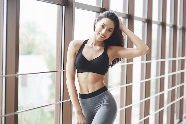 Young sexy sports woman in the gym.