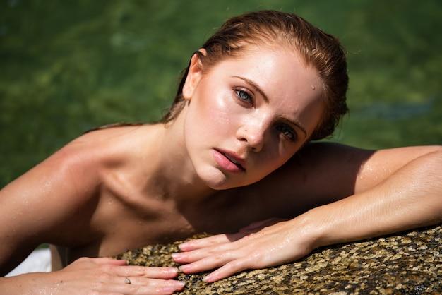 Young sexy woman at sea summer beach sensual girl
