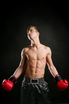 Young shaped man boxing