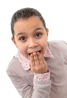 Young shocked girl on white background