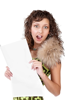 Young shocked stunned funny looking woman reading newspaper isolated on white background. human emotions face expression