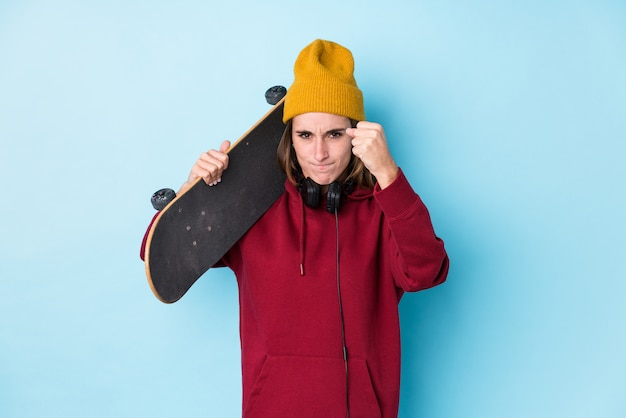 Young skater woman showing fist