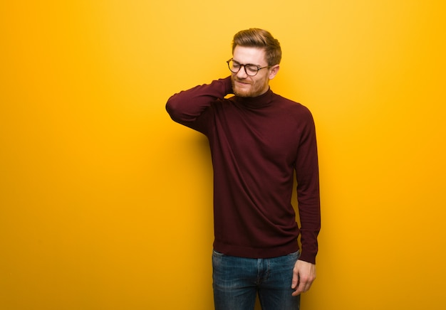 Young smart man suffering neck pain