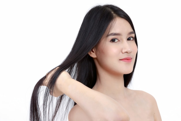Young smile asian woman touch her health long straight hair,beauty hair care
