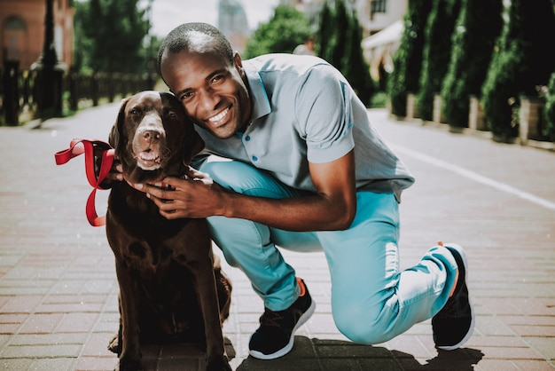 Young smiling african american man petting dog