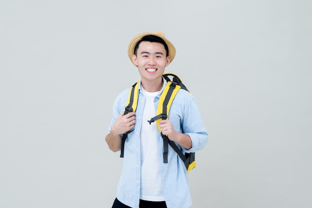 Young smiling asia tourist man backpacker