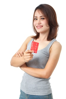 Young smiling  asian woman presenting credit card