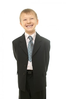Young smiling boy in costume isolated on whiteyoung businessman boy