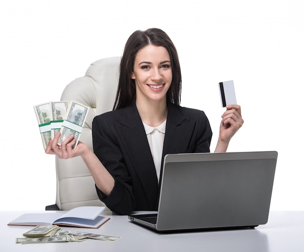 Young, smiling business woman with laptop.
