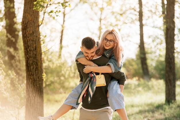 Young smiling couple enjoying in the park.
