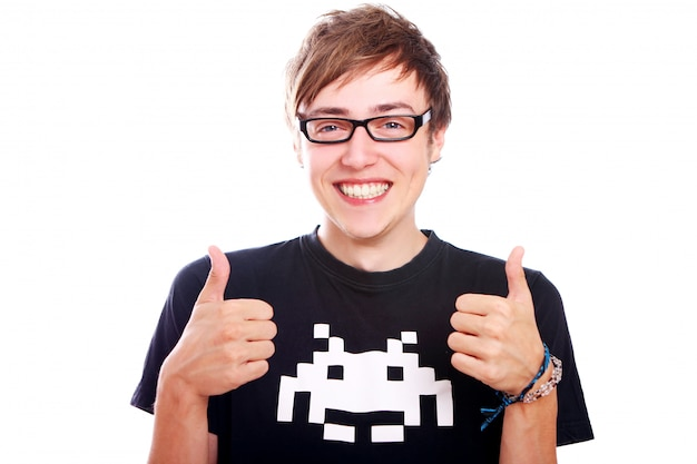 Young smiling guy with thumbs up