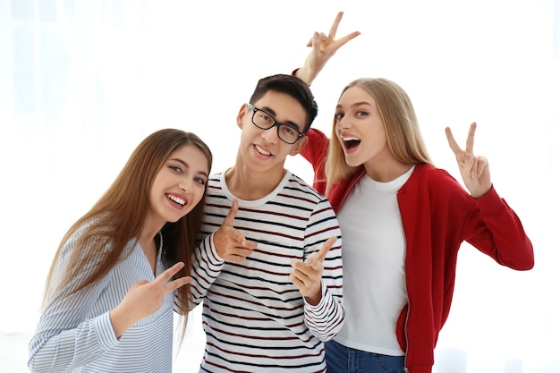 Young smiling people on white background