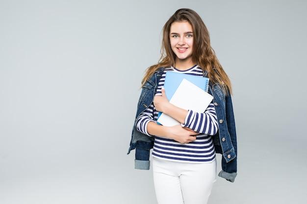 흰색 배경 위에 젊은 웃는 학생 여자