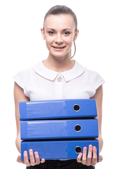 Young smiling woman is holding folders.