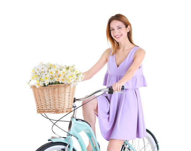 자전거와 절연 꽃 바구니 젊은 웃는 여자