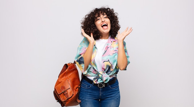 Young smiling woman with curly hair