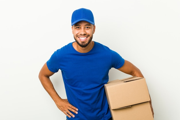 Young south-asian delivery man laughing and having fun