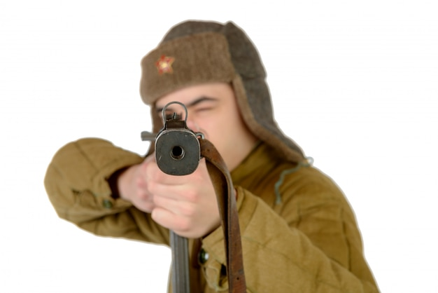 A young soviet soldier  with a machine gun