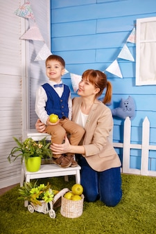 Young speech therapist teaching little boy with voice problems