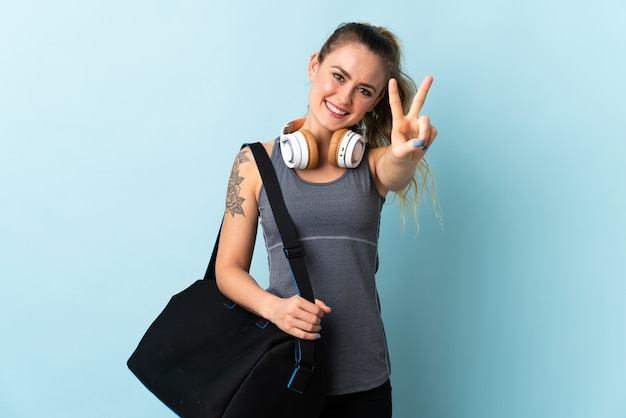 Young sport brazilian woman with sport bag isolated