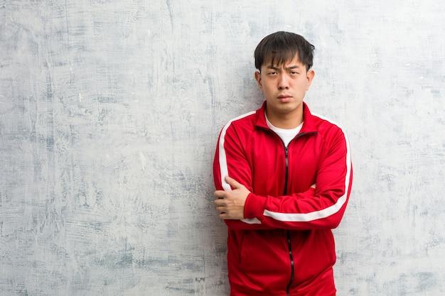 若いスポーツフィットネス中国交差腕リラックス
