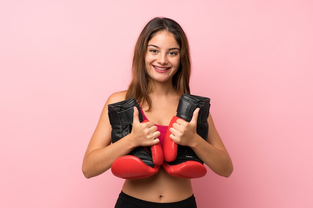 Young sport girl background with boxing gloves