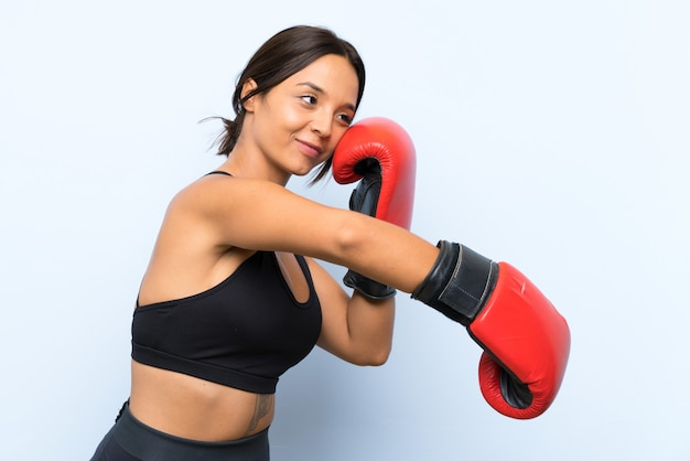 Young sport girl with boxing gloves