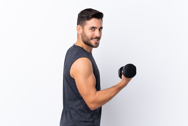 Young sport handsome man with beard over white making weightlifting