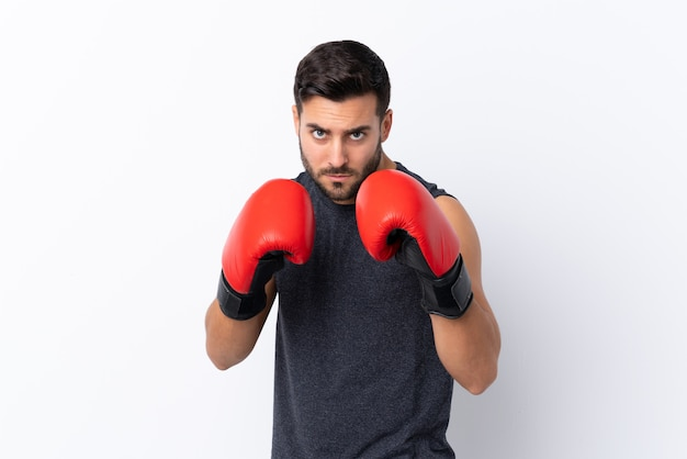 Young sport handsome man with beard over white with boxing gloves