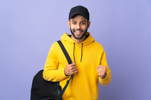 Young sport moroccan man with sport bag isolated
