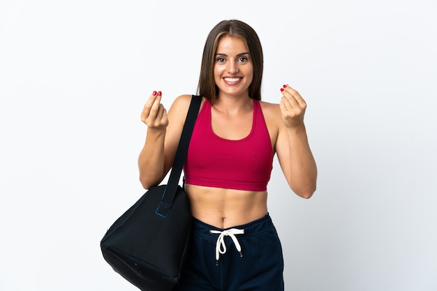 Young sport uruguayan woman with sport bag isolated