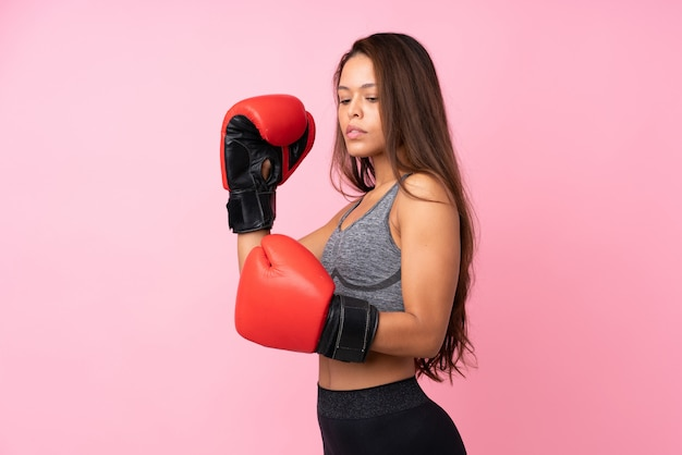 Young sport woman over isolated wall