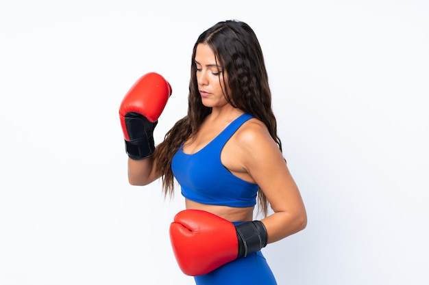 Young sport woman over isolated white background with boxing gloves