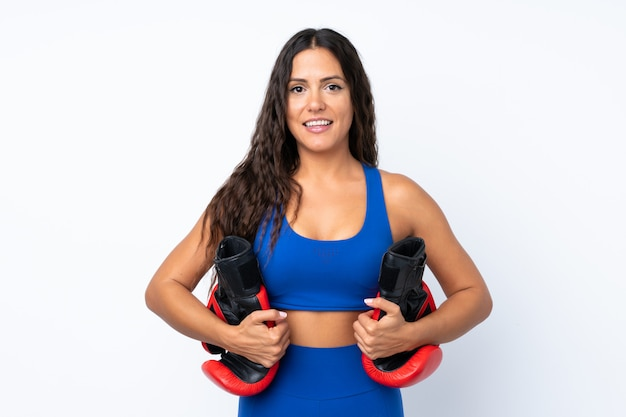 Young sport woman over isolated white  with boxing gloves