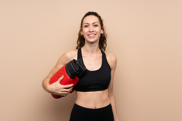 Young sport woman over isolated  with boxing gloves