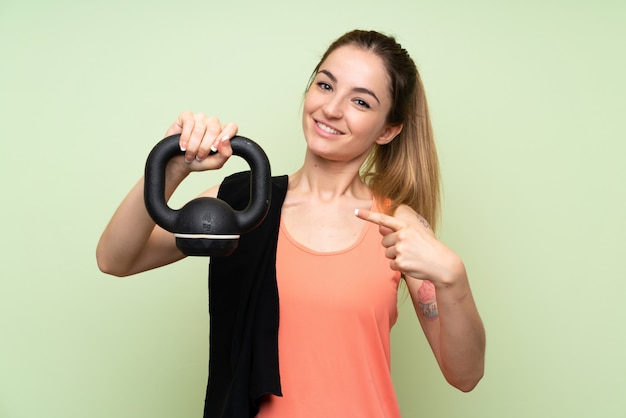 Young sport woman making weightliftingwith with a kettlebell