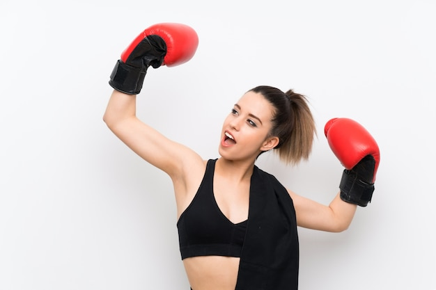 Young sport woman over white wall with boxing gloves