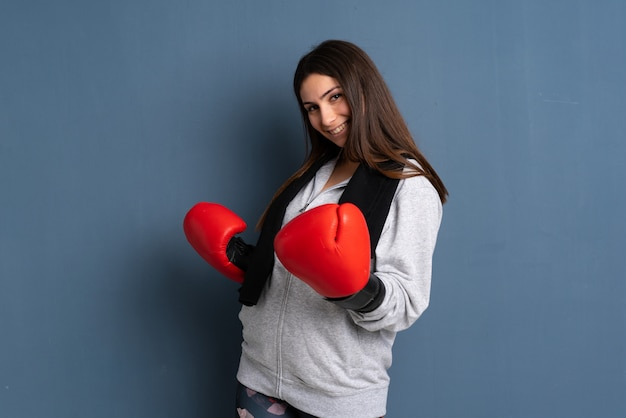 Young sport woman with boxing gloves
