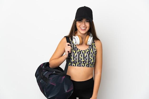 놀라운 표정과 흰색 배경에 고립 된 스포츠 가방 젊은 스포츠 여자