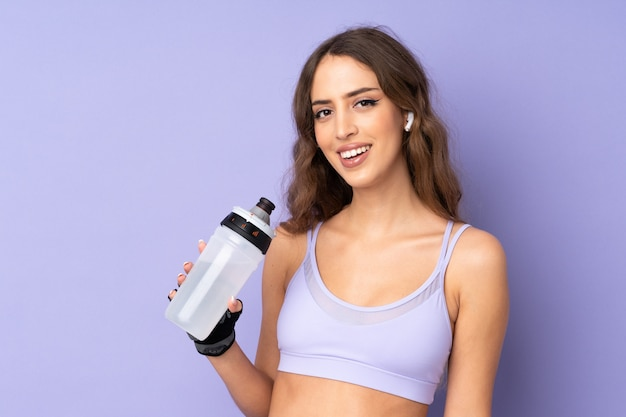Young sport woman with sports water bottle