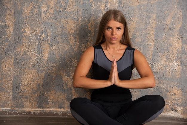 Young sportive girl doing meditation.