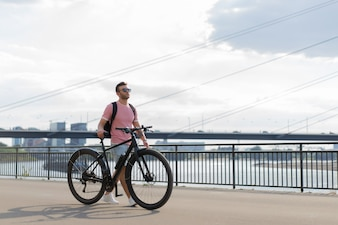 Young sports man on a bicycle in a European city. Sports in urban environments.