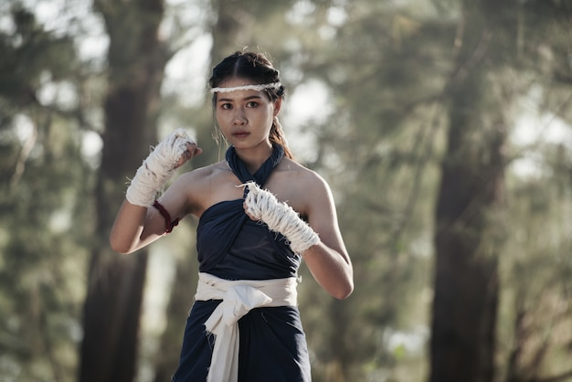 Young sports woman of boxer with white boxing bandages.