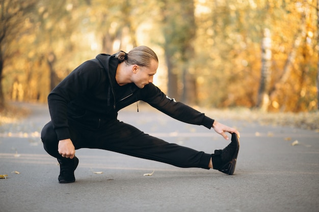Young sportsman exercising in park