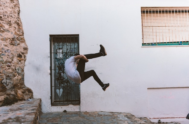 Young sportsman practicing parkour.