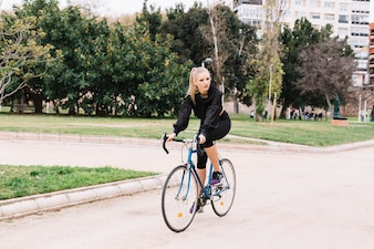 Young sportswoman on bicycle
