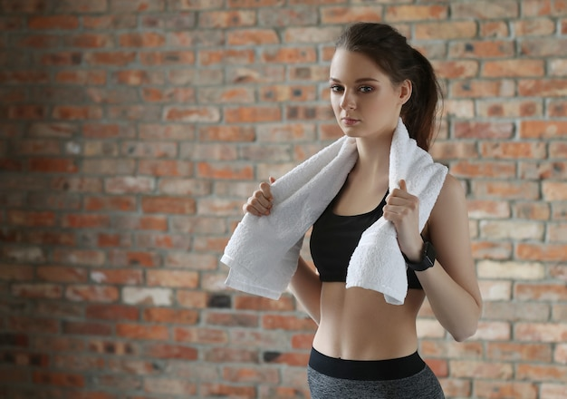 Young sportswoman with towel
