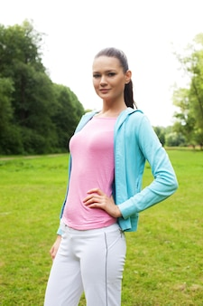 Young sporty brunette woman outdoor. summer day.