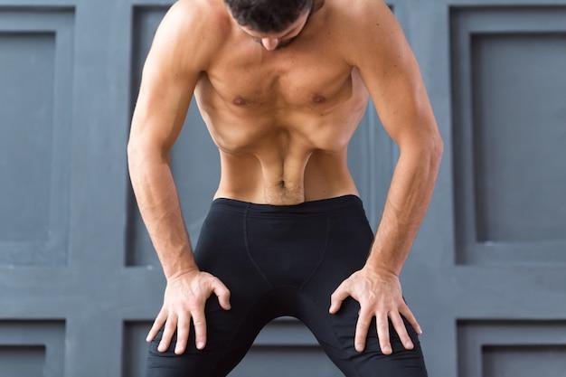 Young sporty men practicing upward abdominal lock