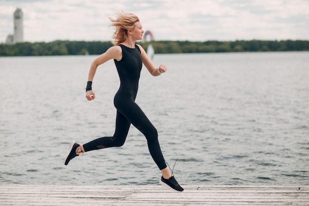 Young sporty woman running